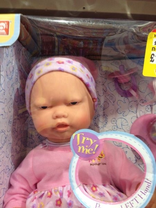 """Mean looking doll in a box stating """"Try me!"""""""