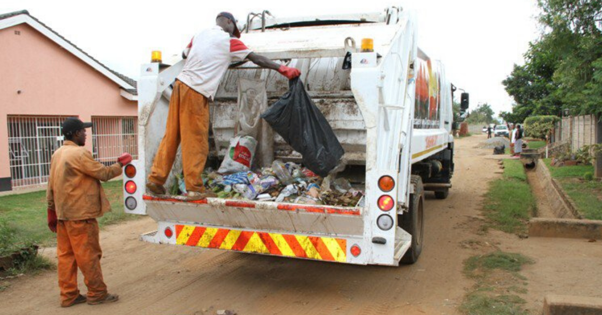 Waste collectors picking trash