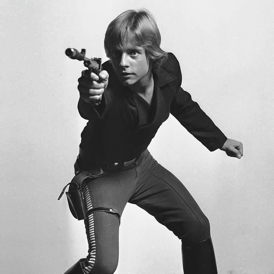 Luke in a snazzy outfit holding a blaster