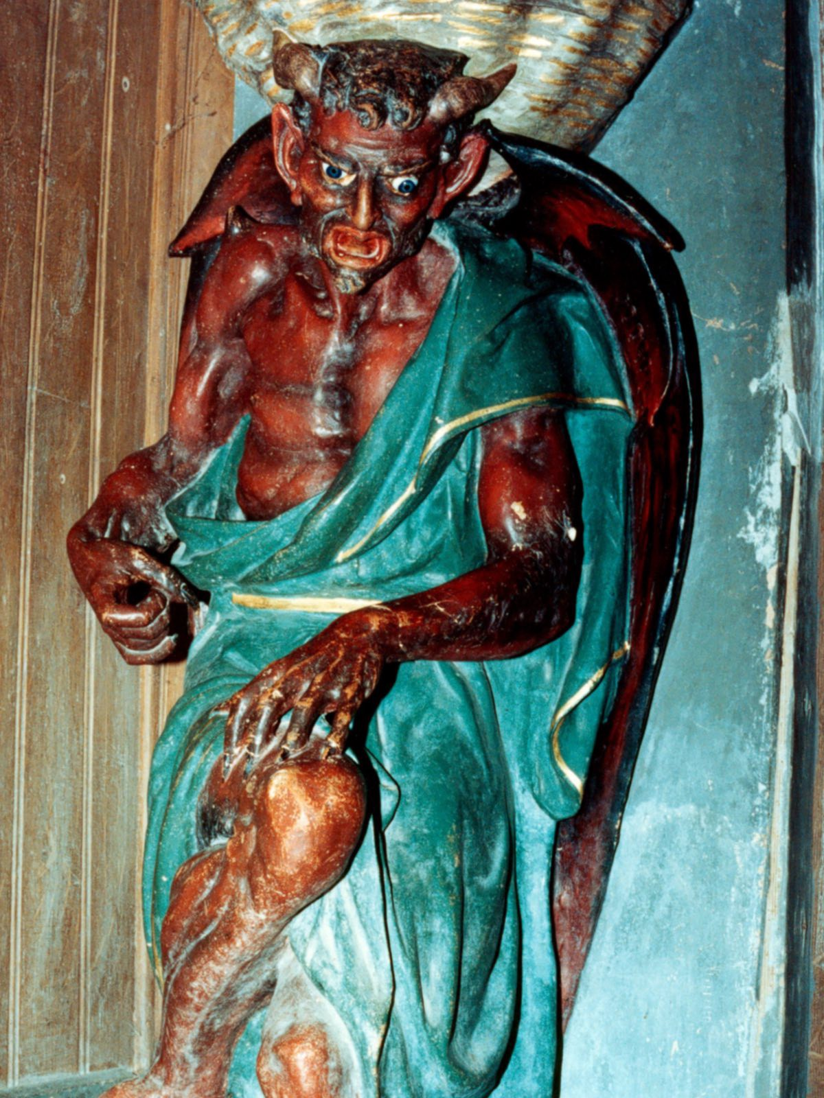 Saunière had this bizarre demonic statue installed near the entrance of the church (credit: Erwan Corre/wiki)