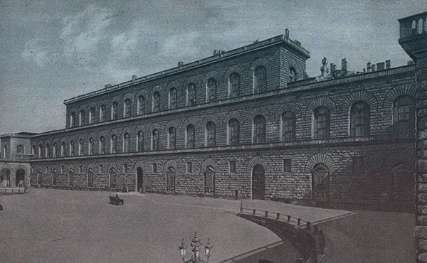A three-story Italian palace with arched gallery windows lining the second and third stories.