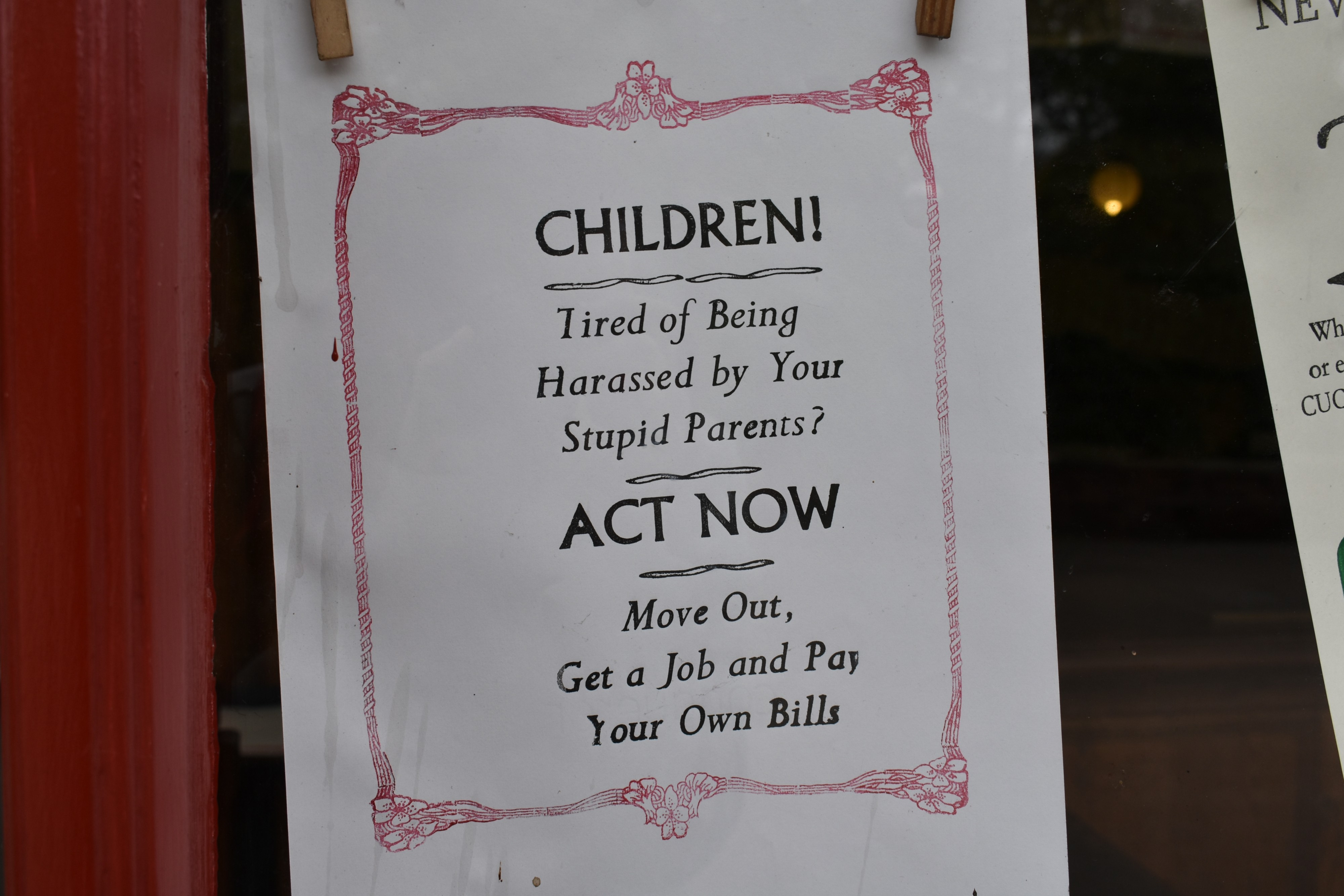 Paper that reads — CHILDREN! Tired of Being Harassed by Your Stupid Parents? ACT NOW. Move out. Get a job.