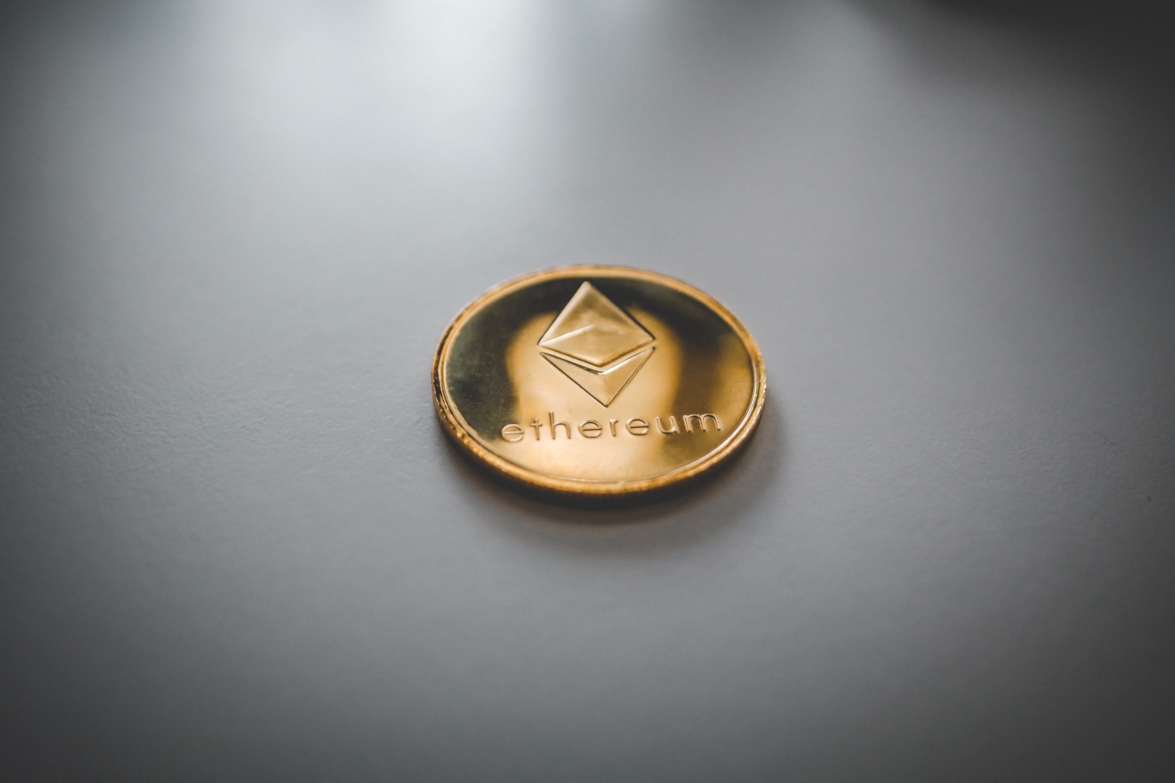 """A coin with the word """"ethereum"""" on it"""