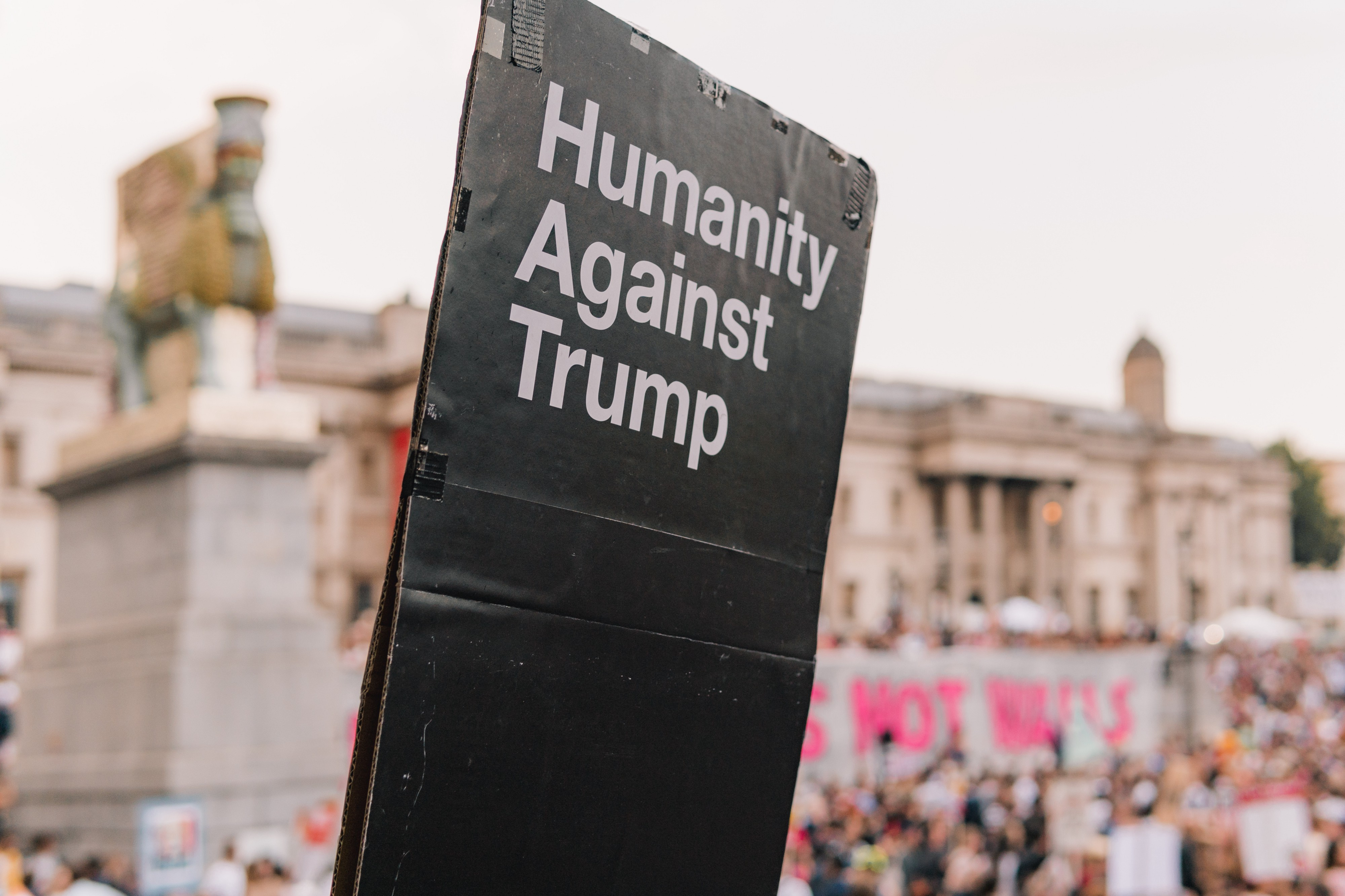 A photo of a protest sign that says, 'humanity against Trump.'