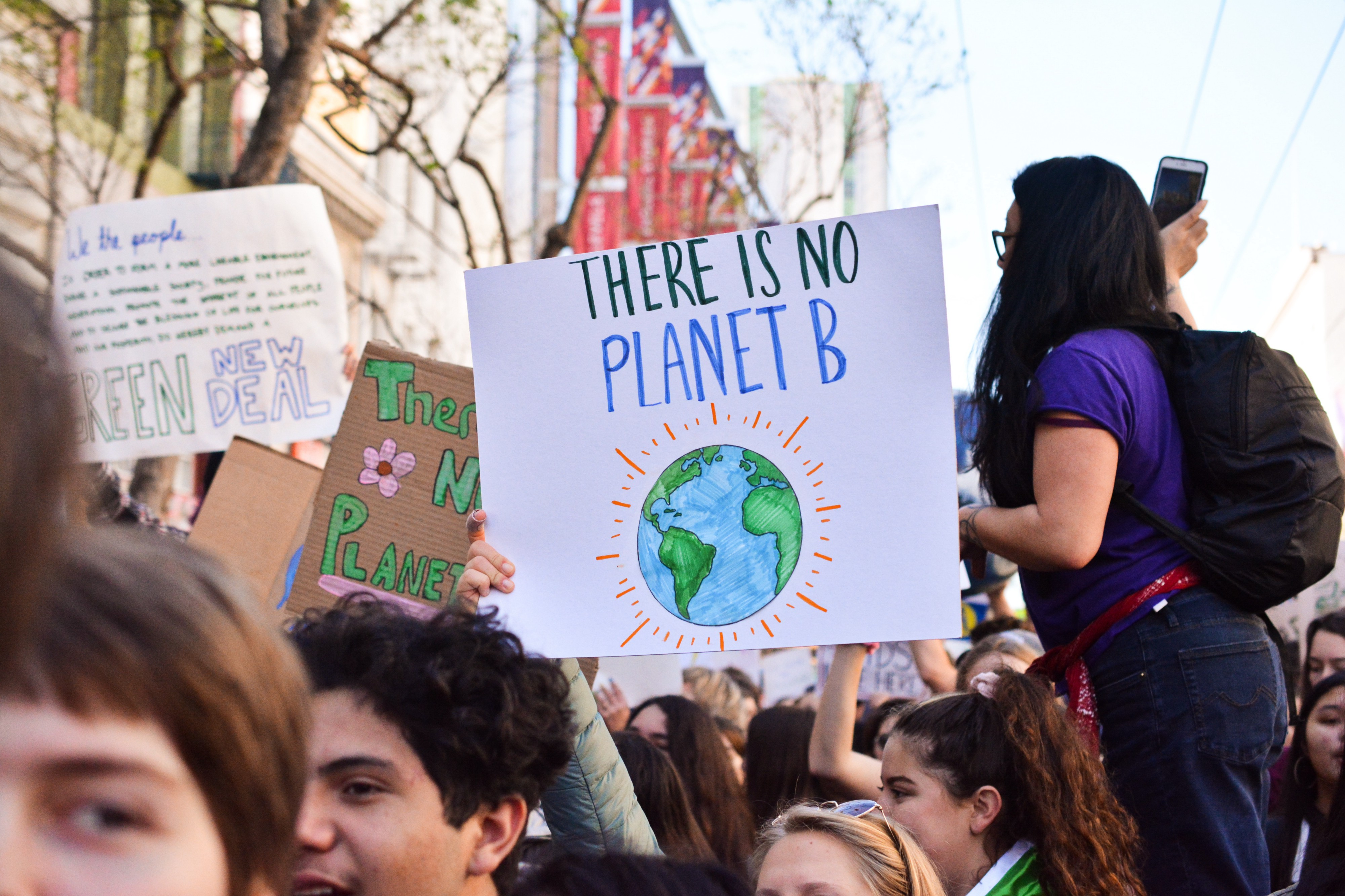 """A sign that appears to be at a climate rally that reads """"there is no planet B"""""""