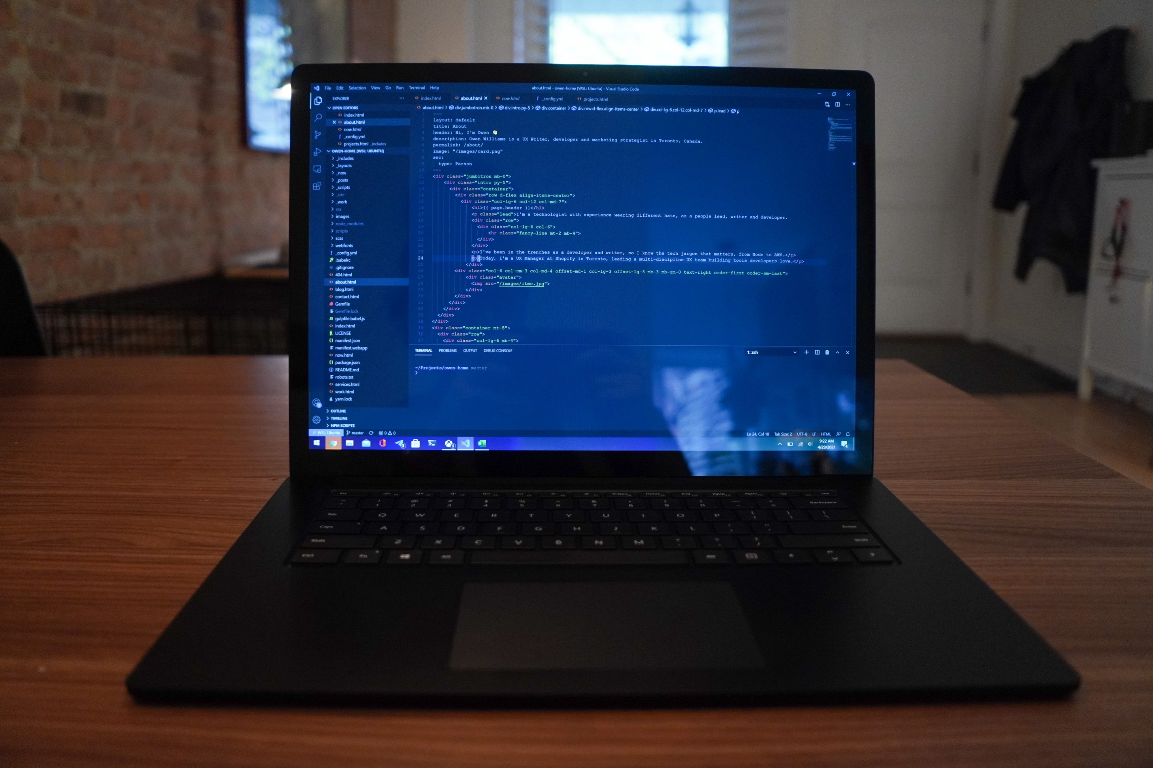 The Surface Laptop 4 on a table with a screen full of code