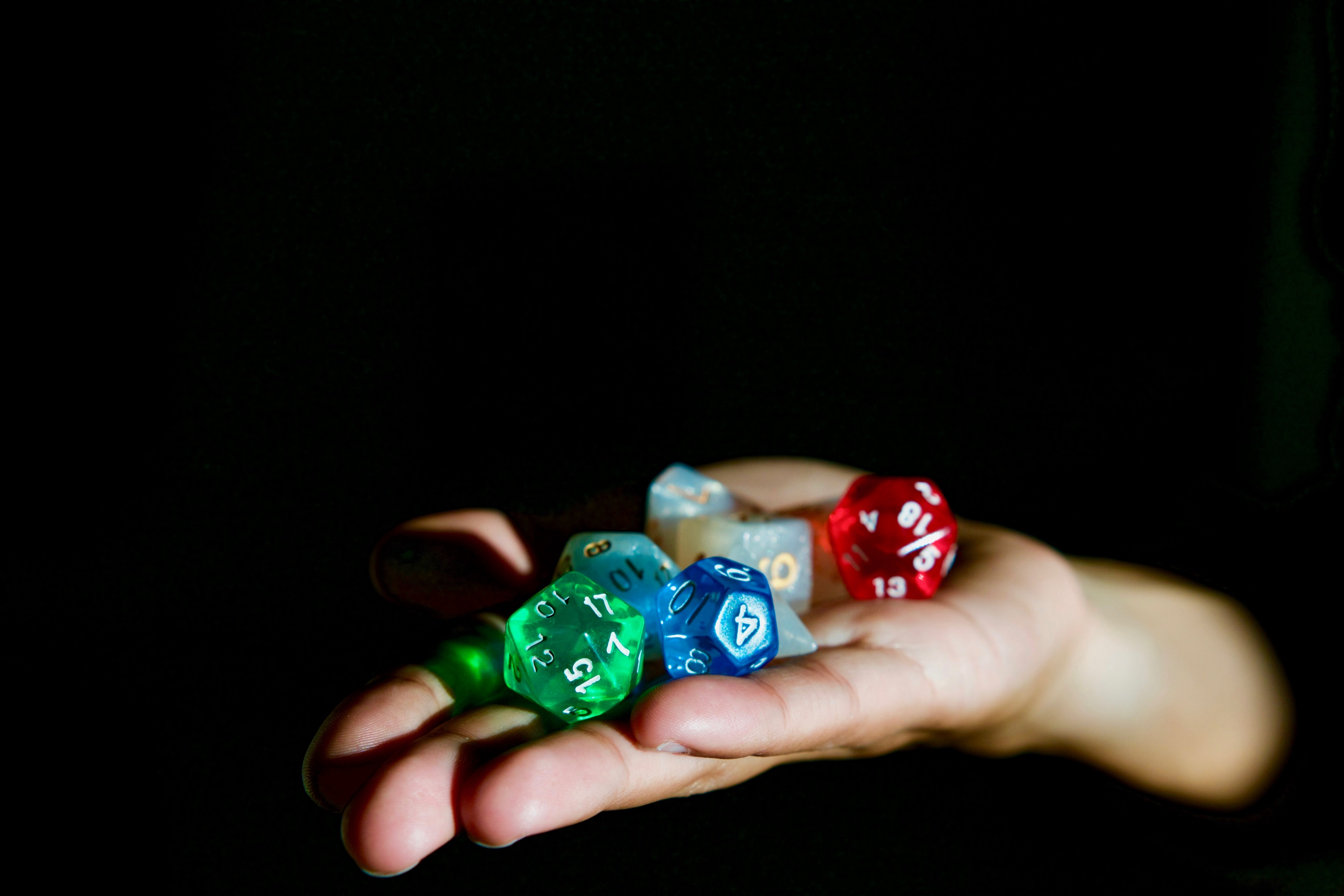 Hand holding funny dice with lots of side