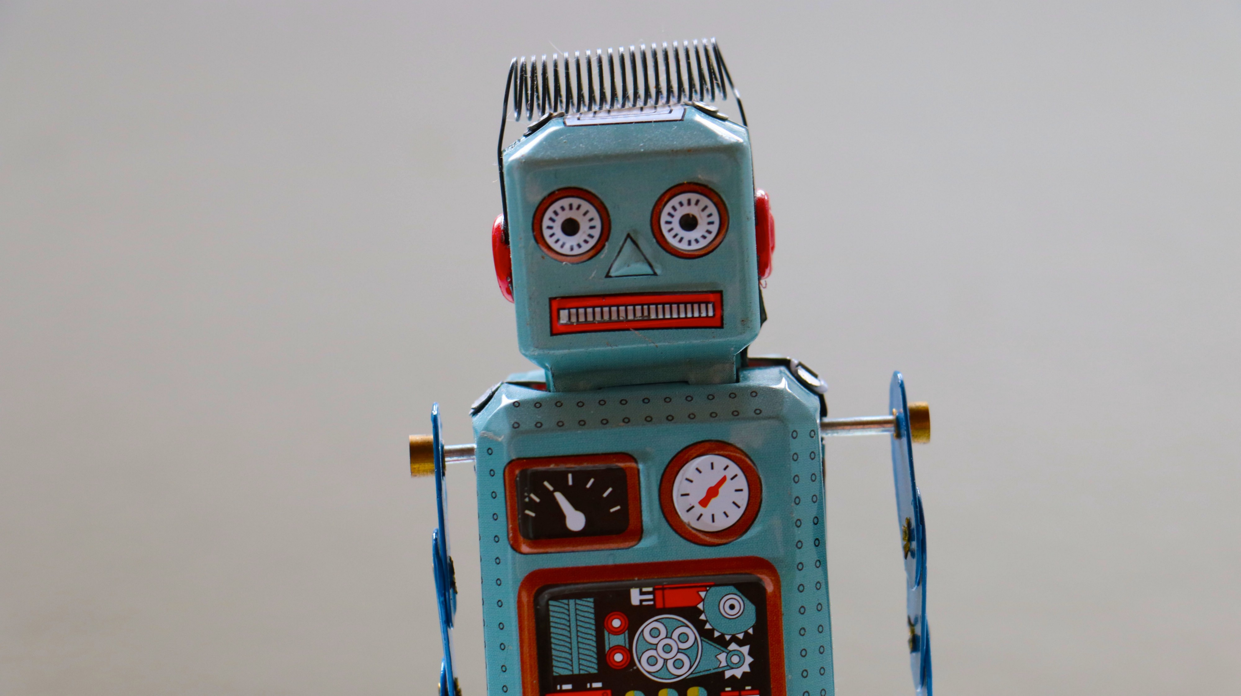 A photo of a blue toy robot.