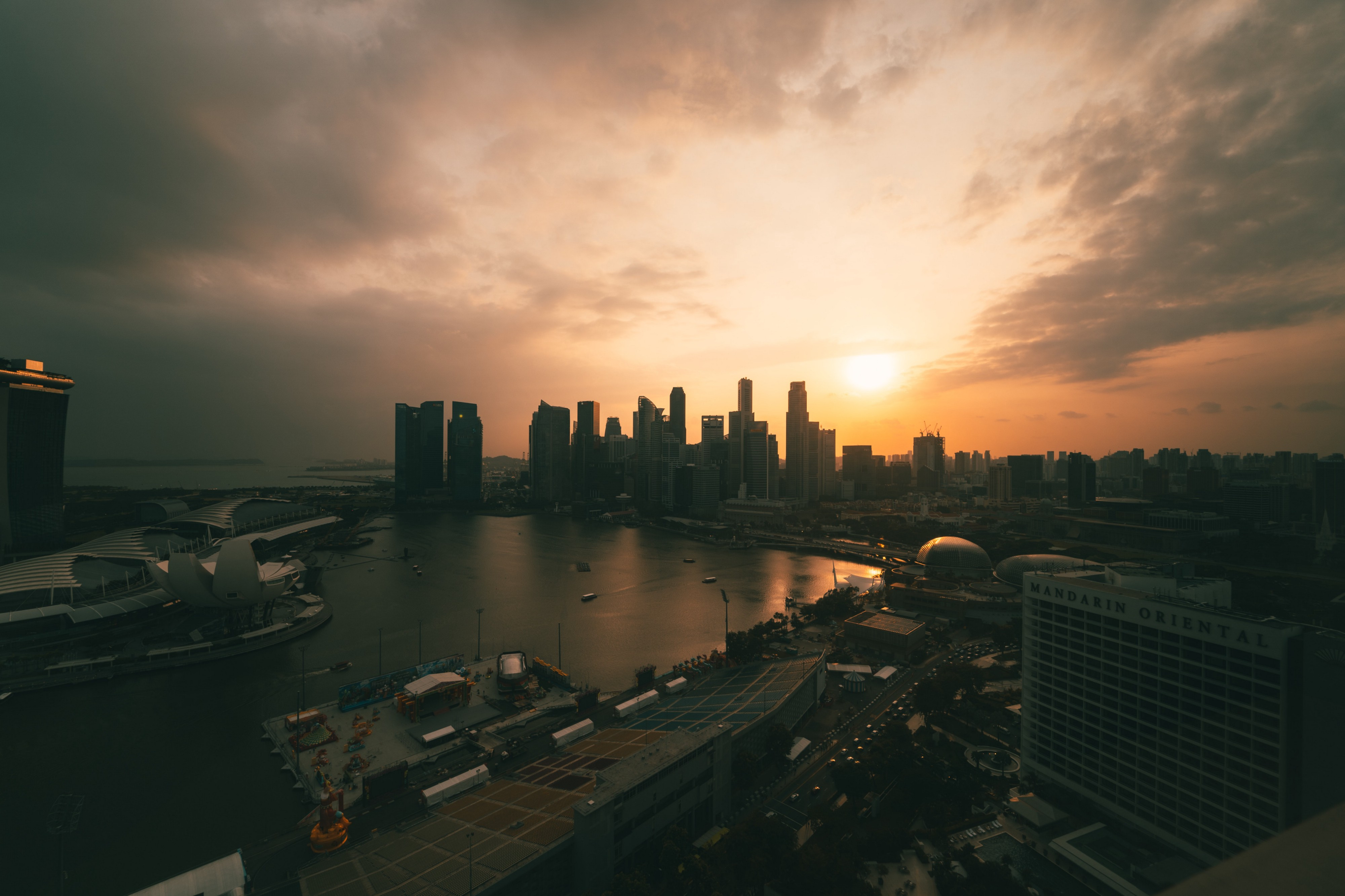 A glorious view of Singapore beneath a setting sun.