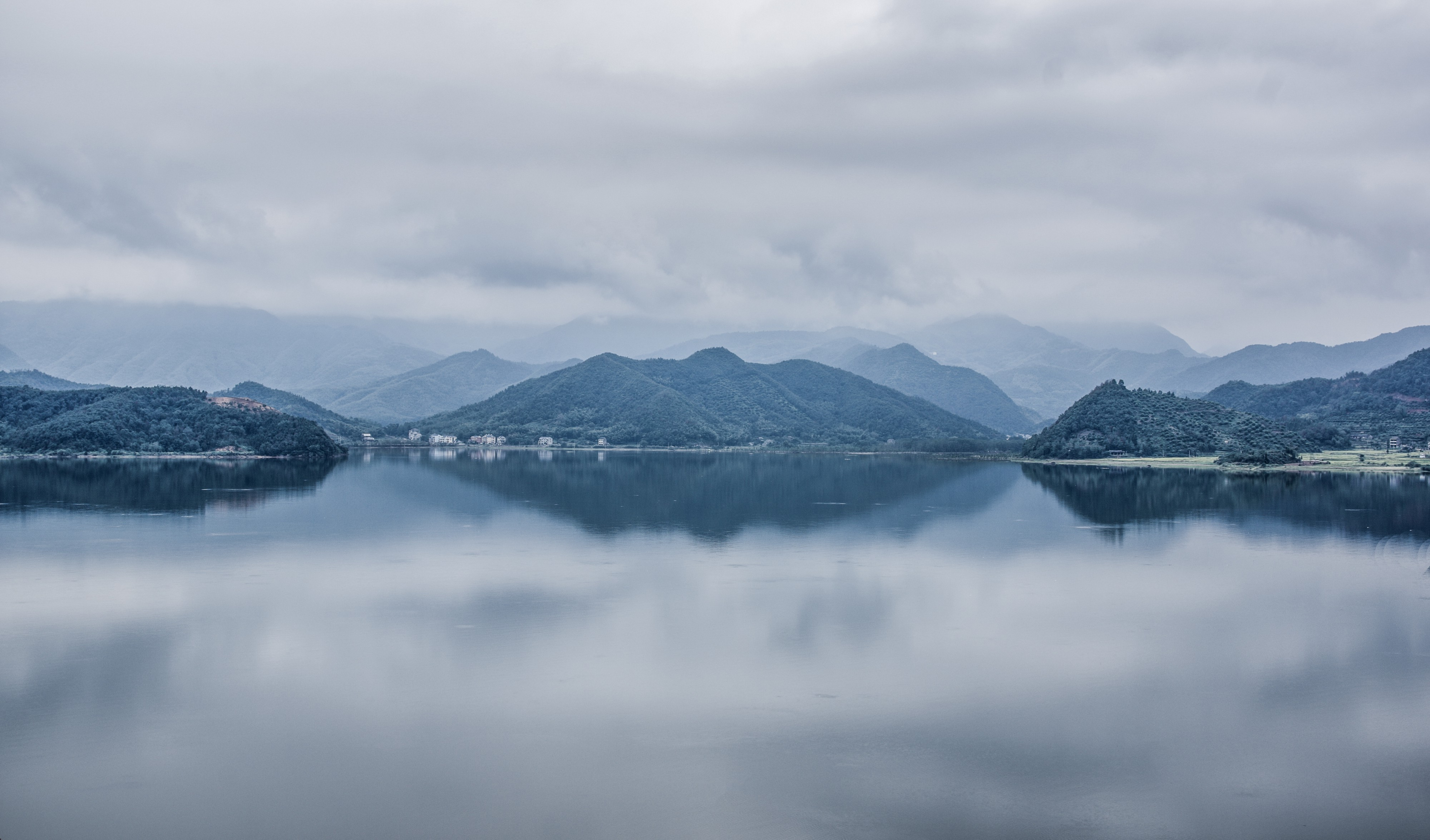 A wide lake with mountains in the background. Perfect for reflections.