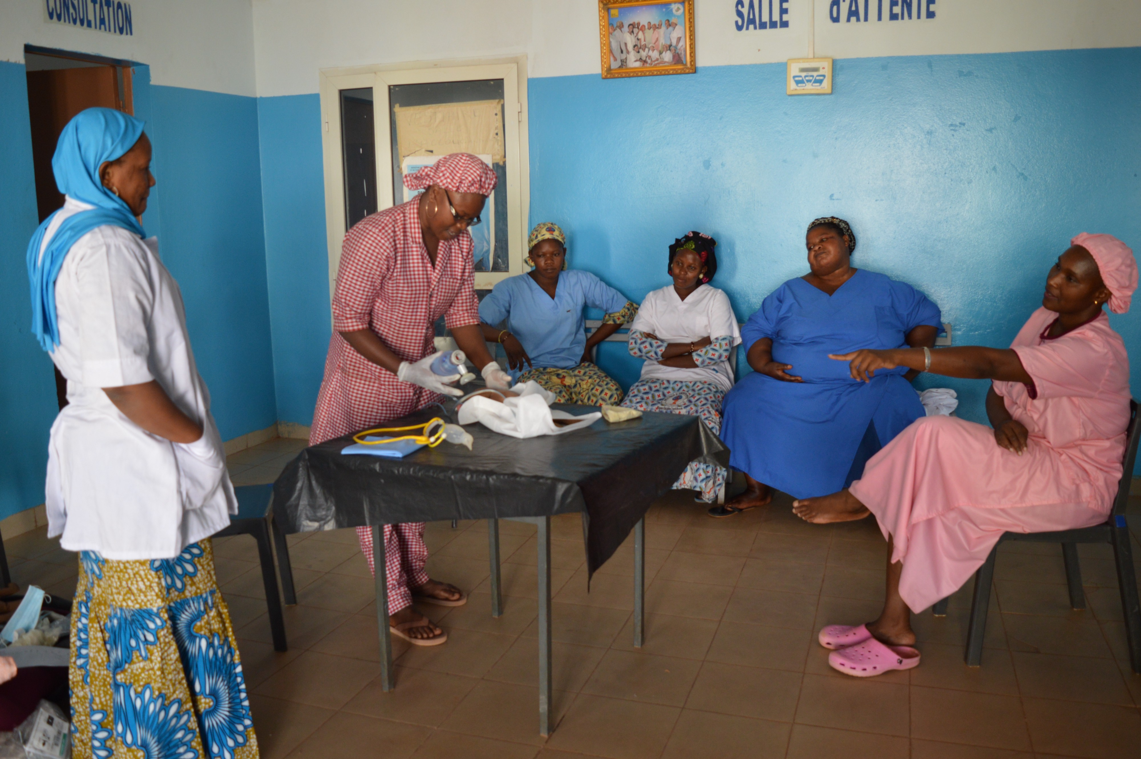 Mama Diancoumba provides coaching to her peers after training she received through a USAID program.