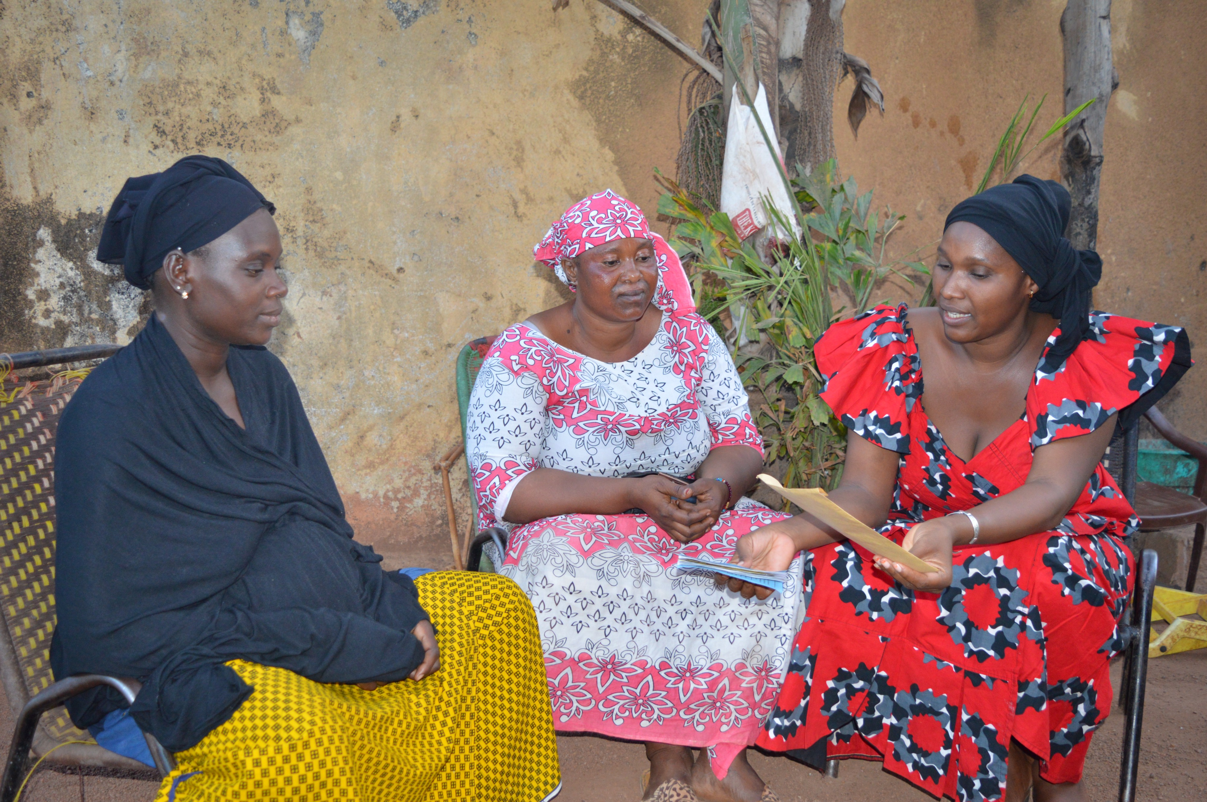 In her neighborhood, Mama Diancoumba discusses and advises other women on the health issues.