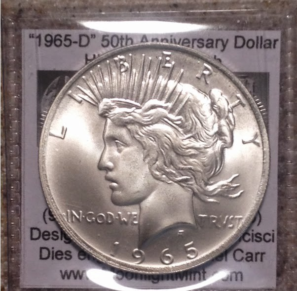A fantasy overstruck silver dollar with an impossible 1965 date