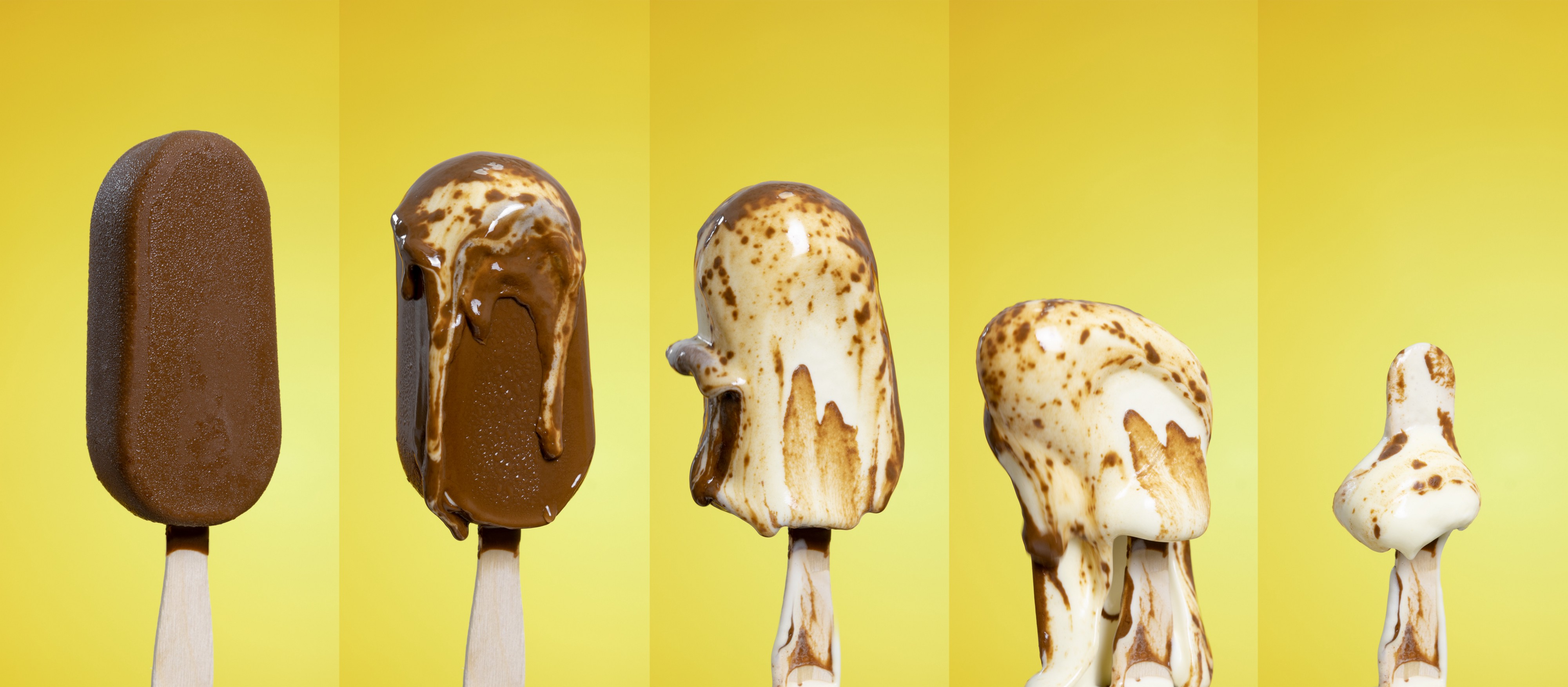 Ice Cream bar in 5 different stages of melting ranging from not melted to completely melted