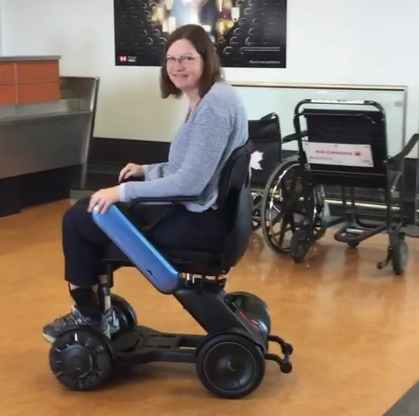 Sheri Byrne-Haber in her new Whill wheelchair at the Montreal Airport