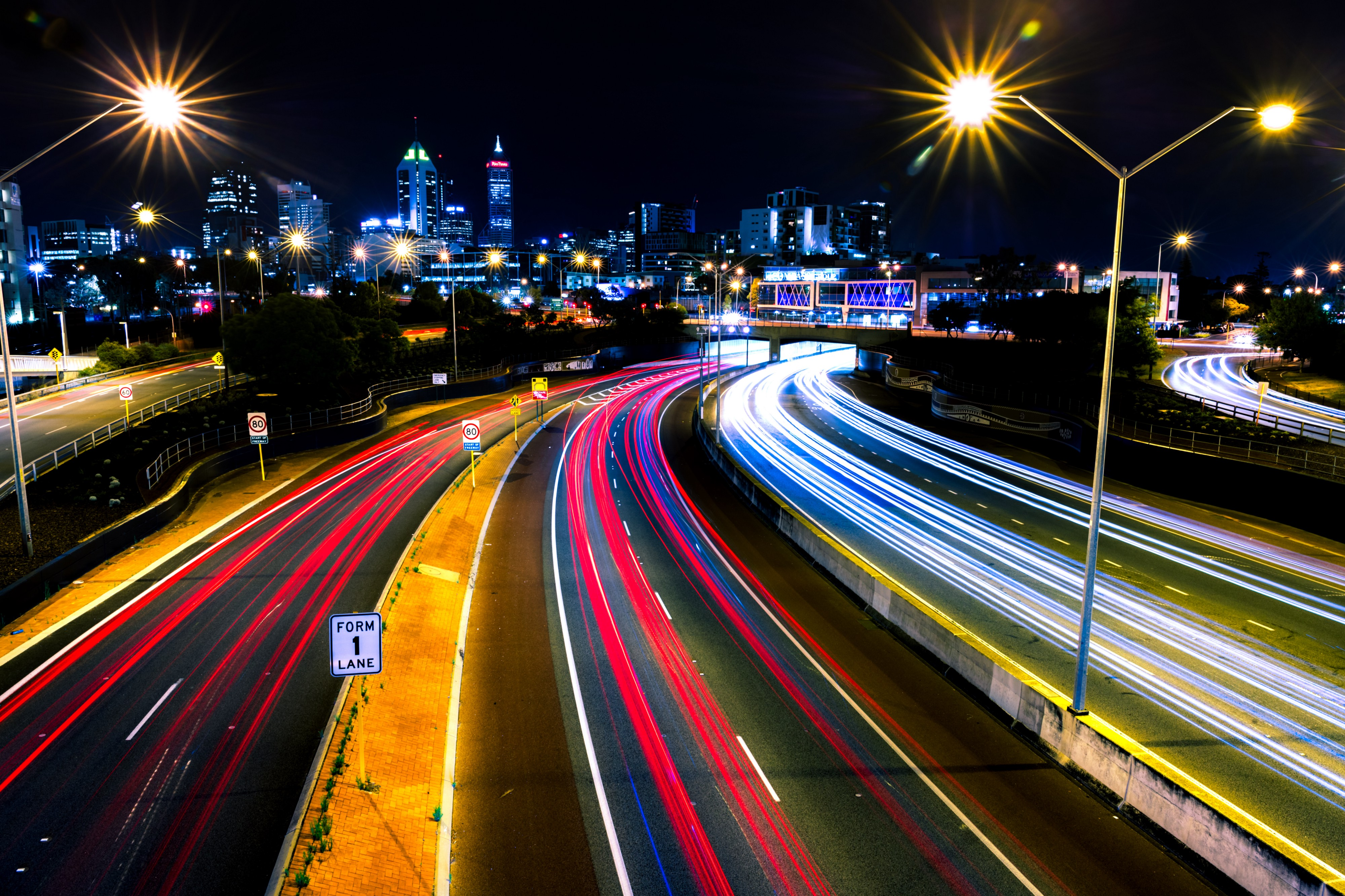 highway roads illuminated at night by cars and street lights