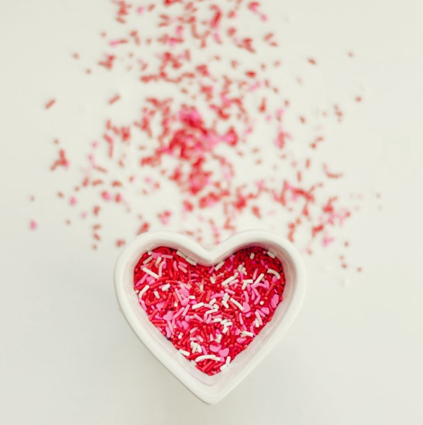 Valentines cookie sprinkles in chaos rounded into a heart shaped jar