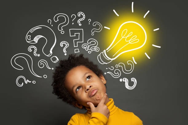 A stock image of a Black child thinking