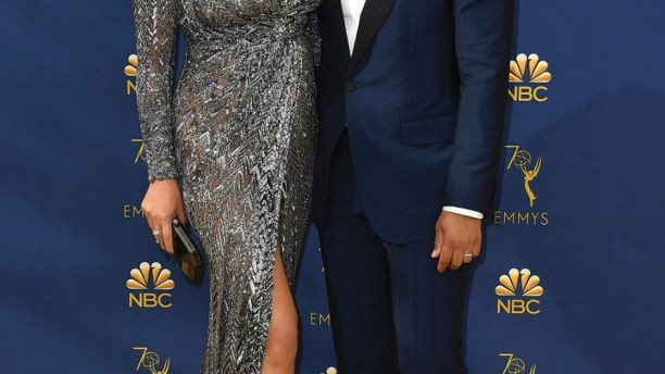Chrissy Teigen, left, and John Legend arrive at the 70th Primetime Emmy Awards on Monday, Sept. 17, 2018, at the Microsoft Theater in Los Angeles. (Photo by Jordan Strauss/Invision/AP)