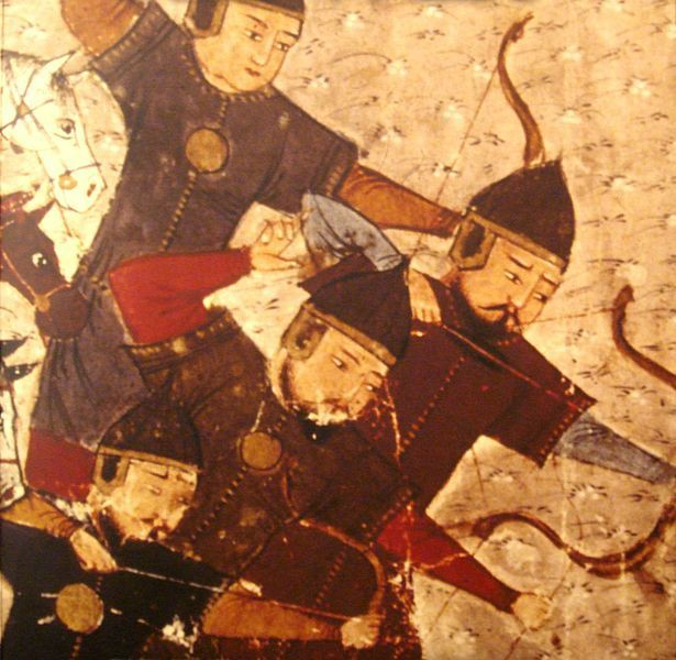 Four Asian archers in armor draw arrows & fire. Three horses are behind them.
