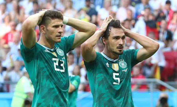 German players Mario Gomez (23) and Mats Hummels (5)