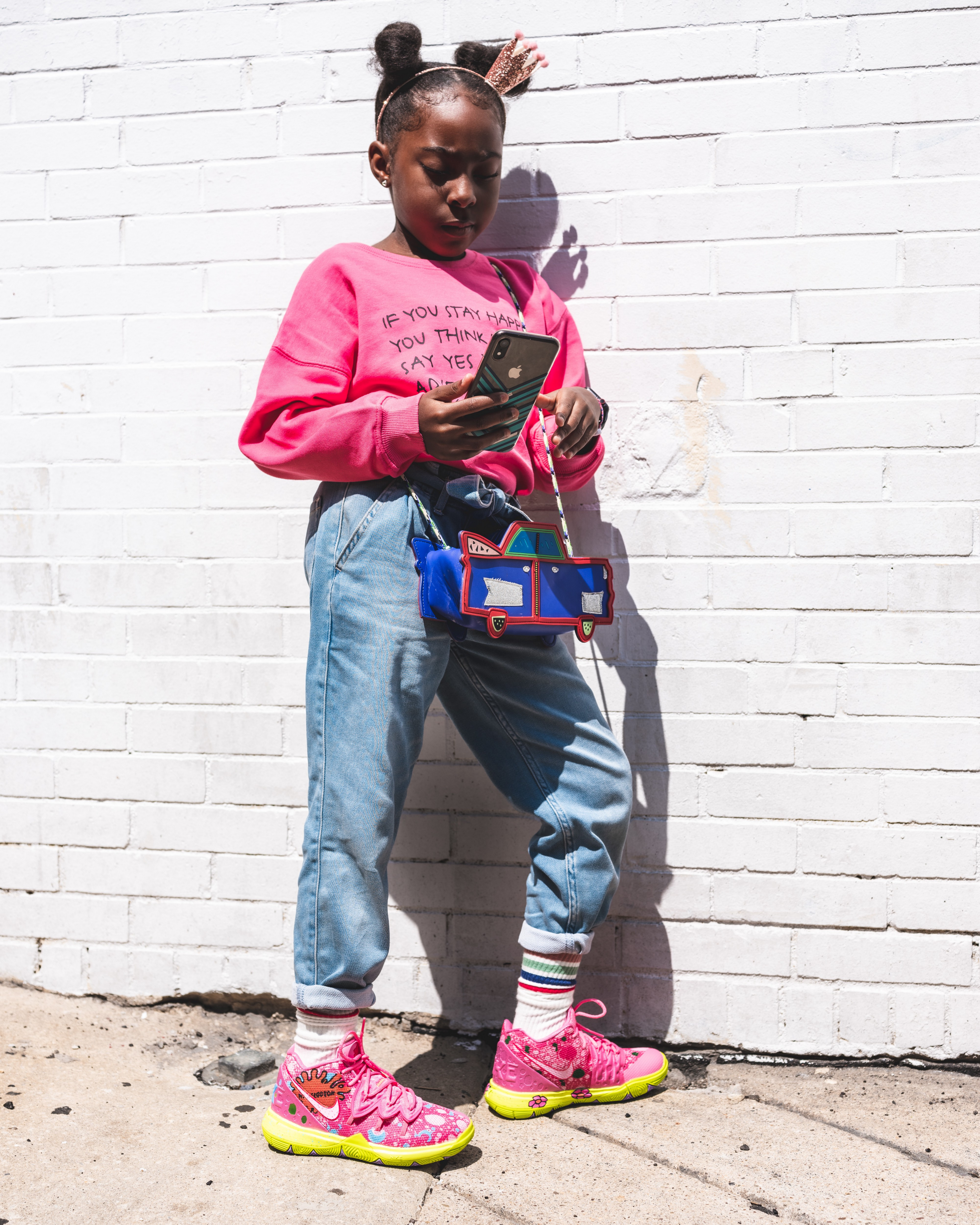 Fashionable young girl looking at her phone