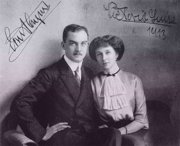 Ernst August in a dark suit and Viktoria Luise in a white blouse with layered cravat.