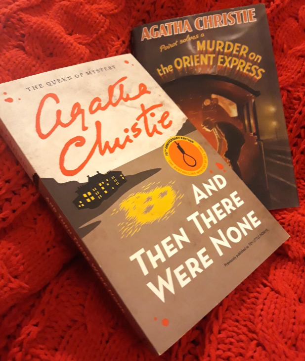 A paperback of And Then There Were None and a hardback of Murder on the Orient Express. They are on a red background.