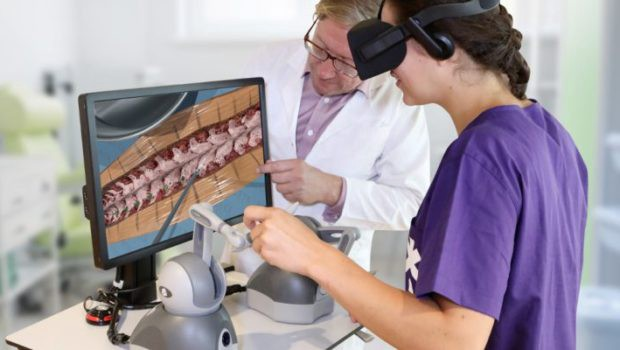 A surgeon being trained with a robotic-AR technology that takes in joystick input from a physical scalpel. The procedure is b