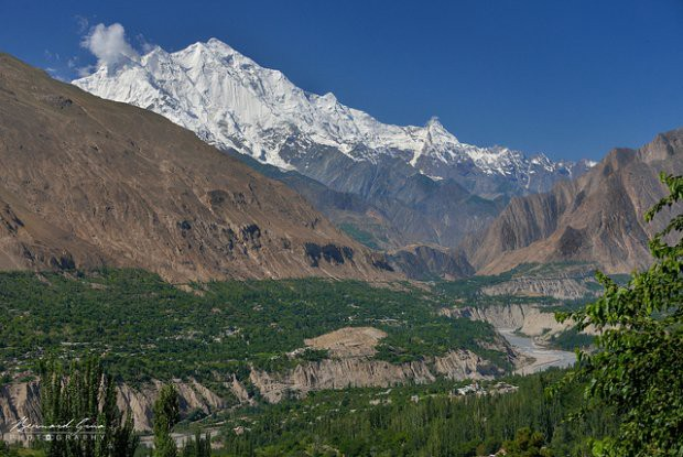View of the valley from Karimbad, Gilgit-Baltistan. At the bottom of a trench cut in alluvium &moraines, flows Hunza River