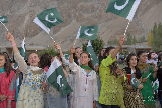 Young women from the upper Hunza valley waving Pakistani flags during the FACE festival—Photo © Bernard Grua 2018