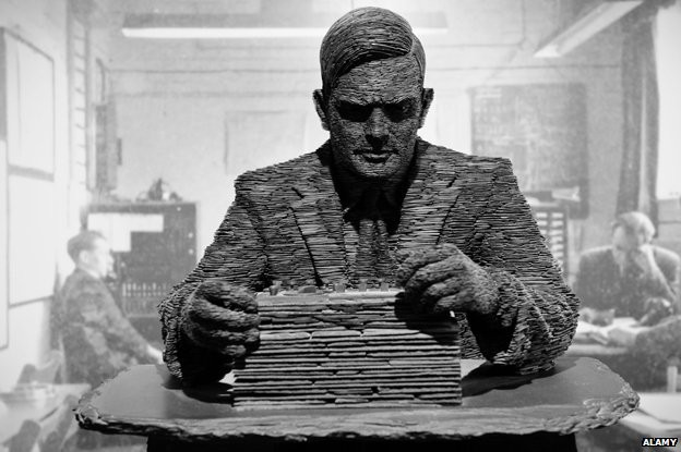 Another statue of Alan Turing working at a desk