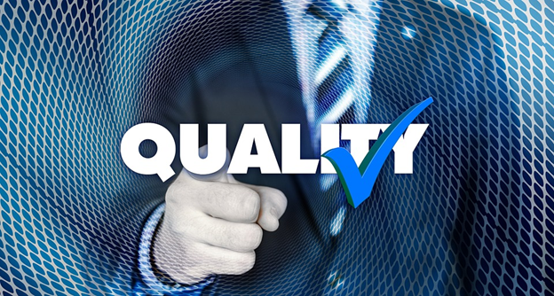 """Stylized photo of a man pointing at the camera with the word """"Quality"""" and a blue checkmark."""