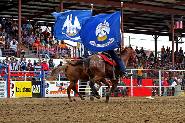 """""""Angola Prison Rodeo Flag Show"""" by crawford orthodontics is licensed under CC BY-NC-SA 2.0"""