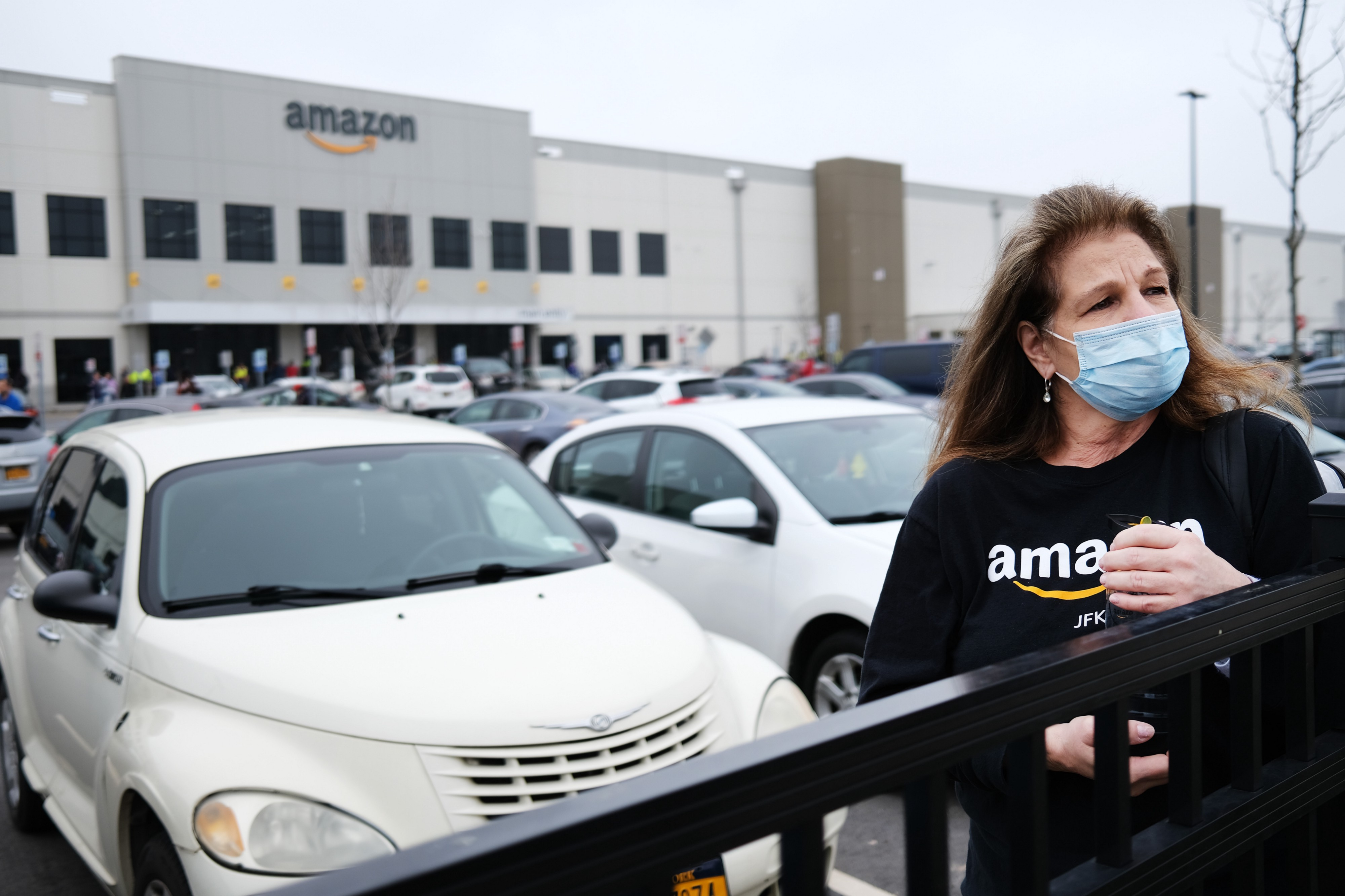 An Amazon employee wears a mask outside of the Staten Island warehouse during a walkout over lack of employee protection.