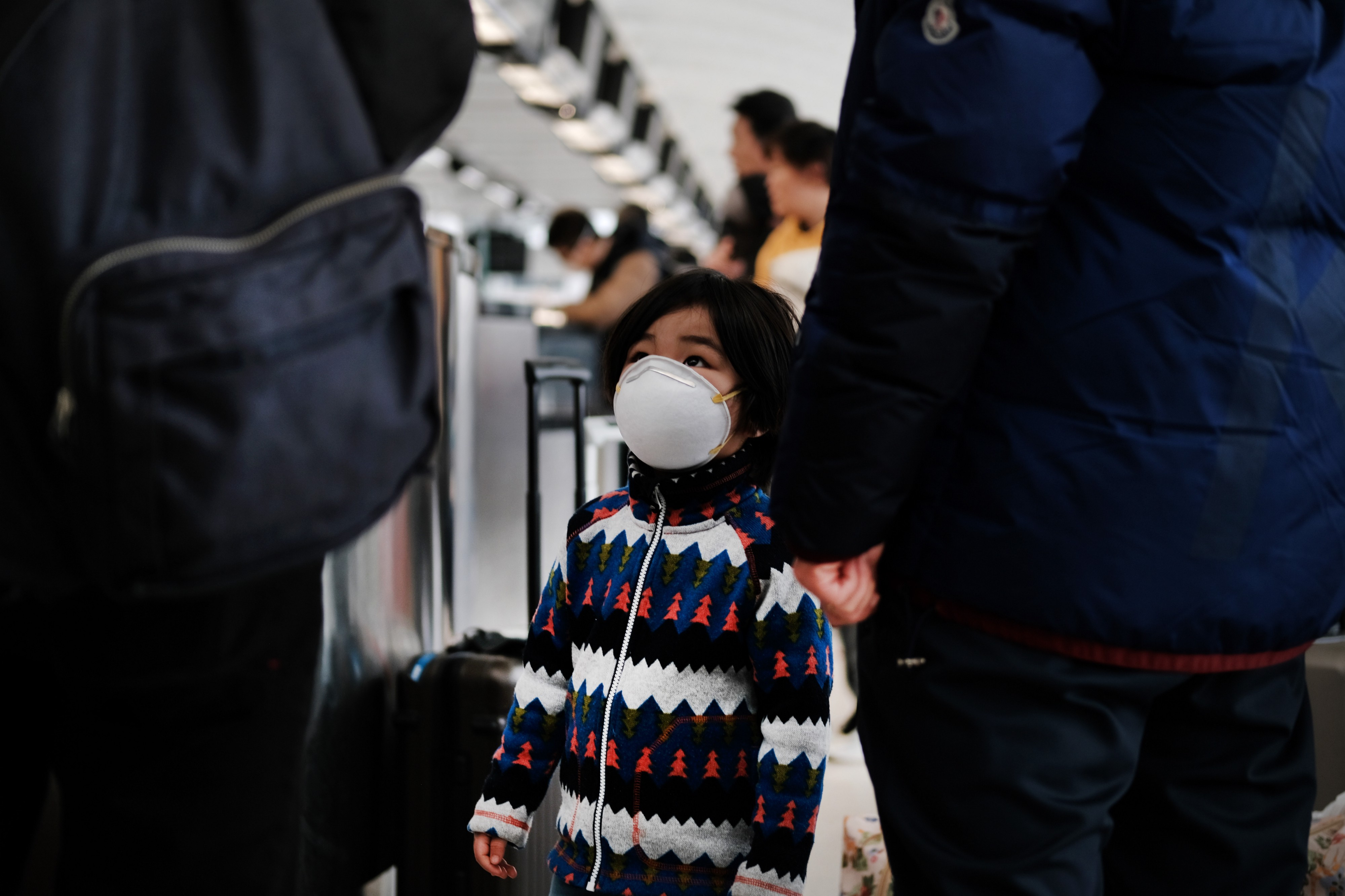 A child wears a medical mask out of concern over the Coronavirus at the JFK terminal that serves planes bound for China.