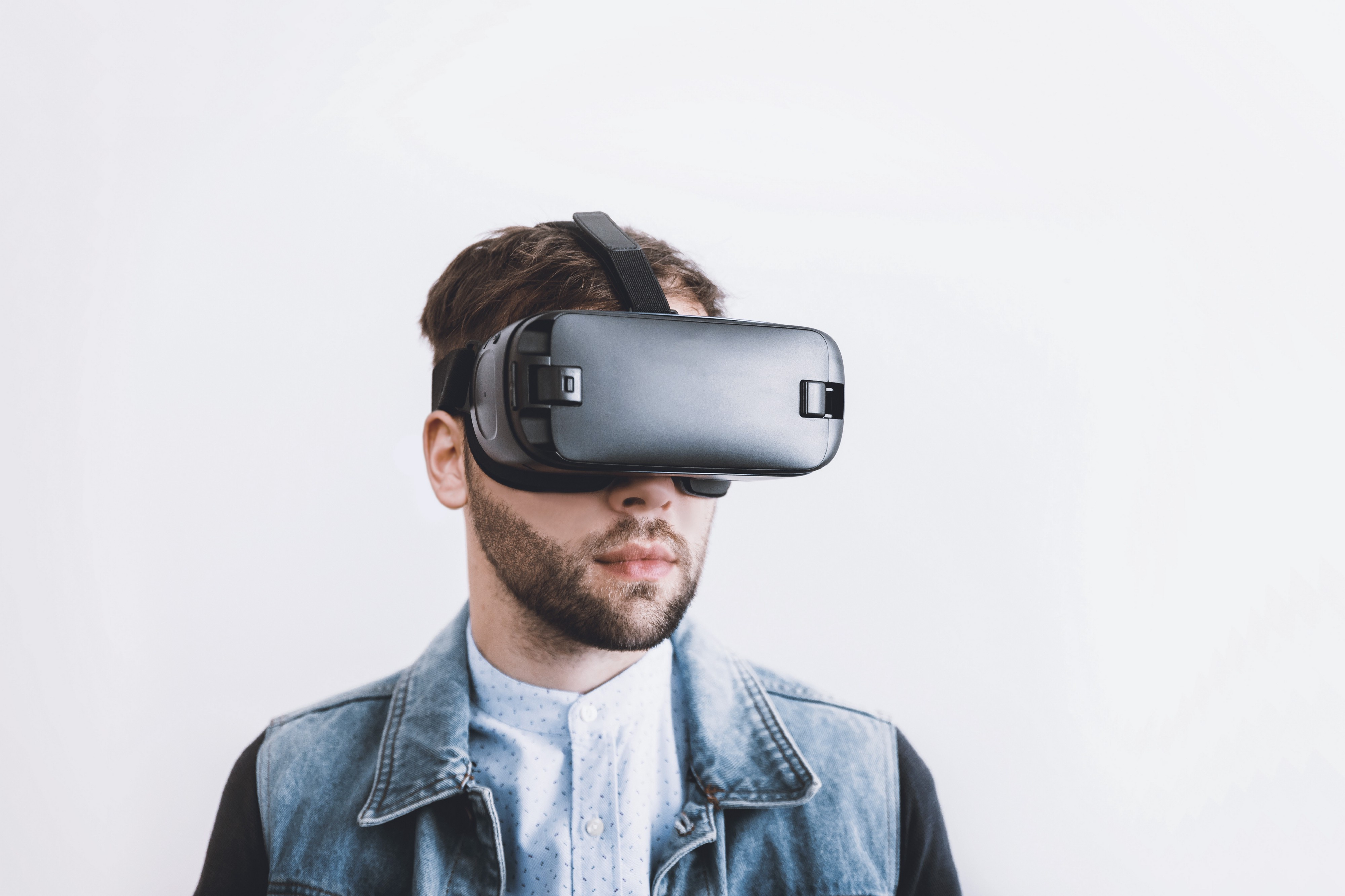 Male wearing virtual reality system over eyes