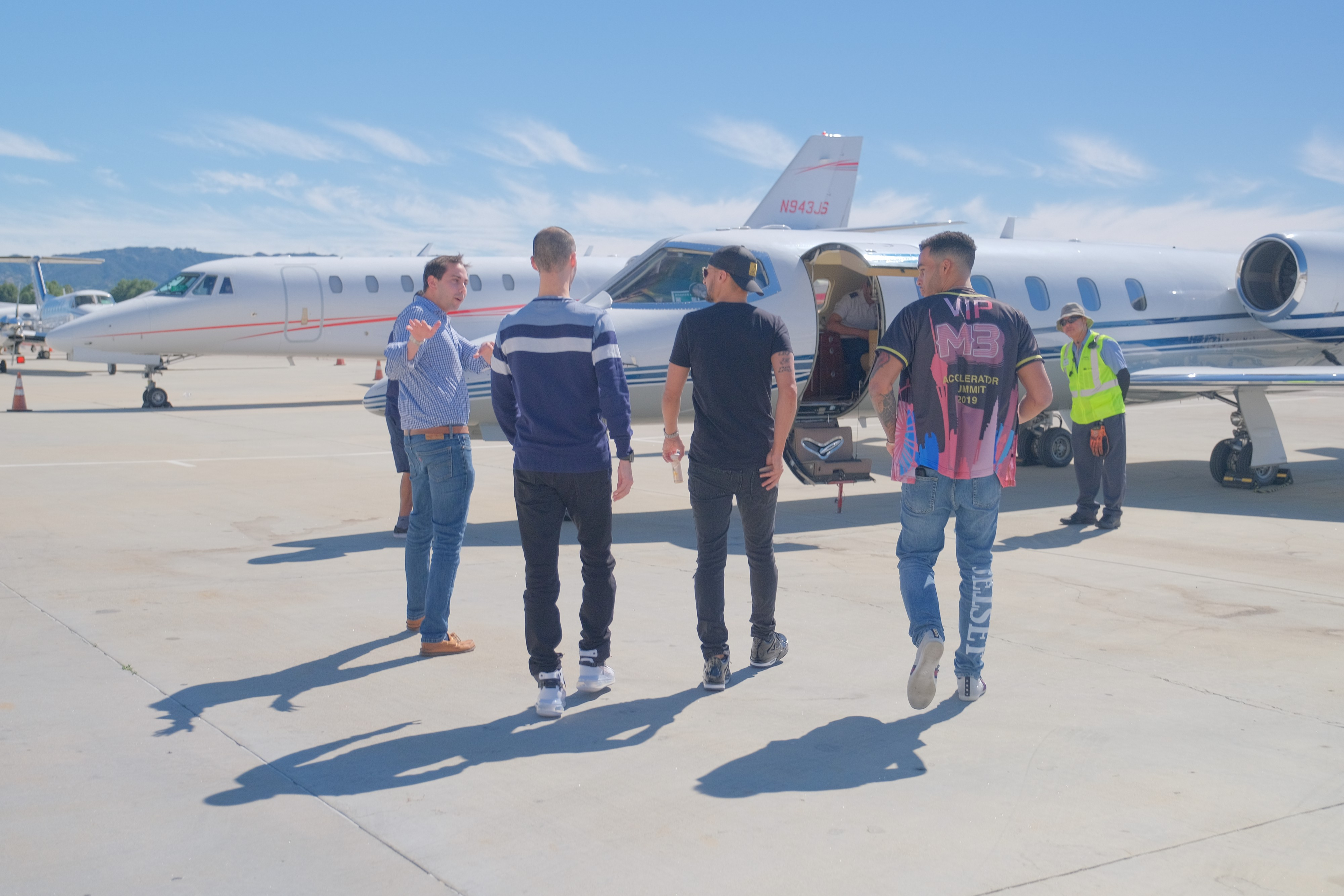 4 male celebrities walking on private jet to fly & travel on luxury trip