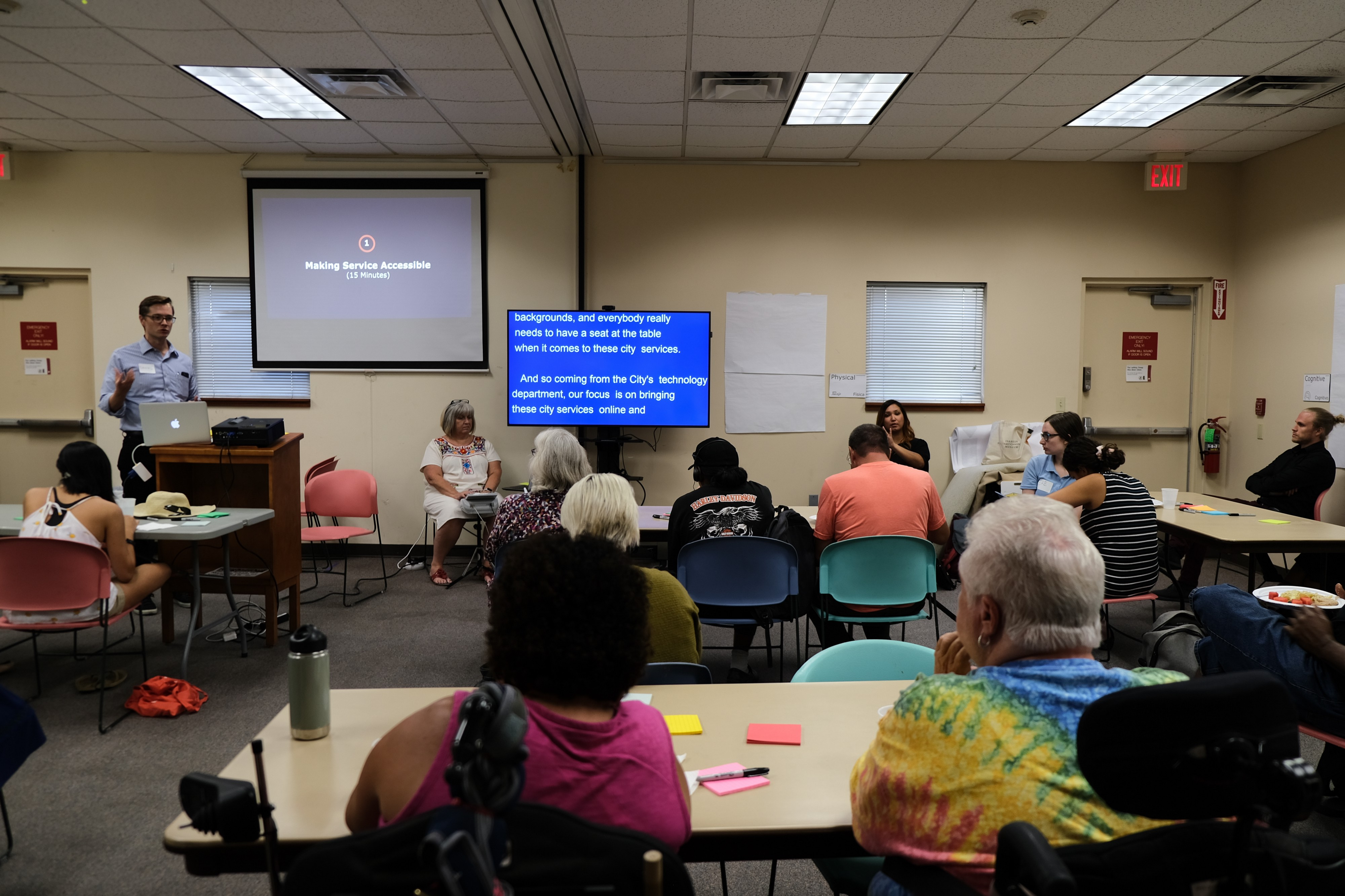 """Group of people attend an accessibility workshop """"Making services accessible."""""""