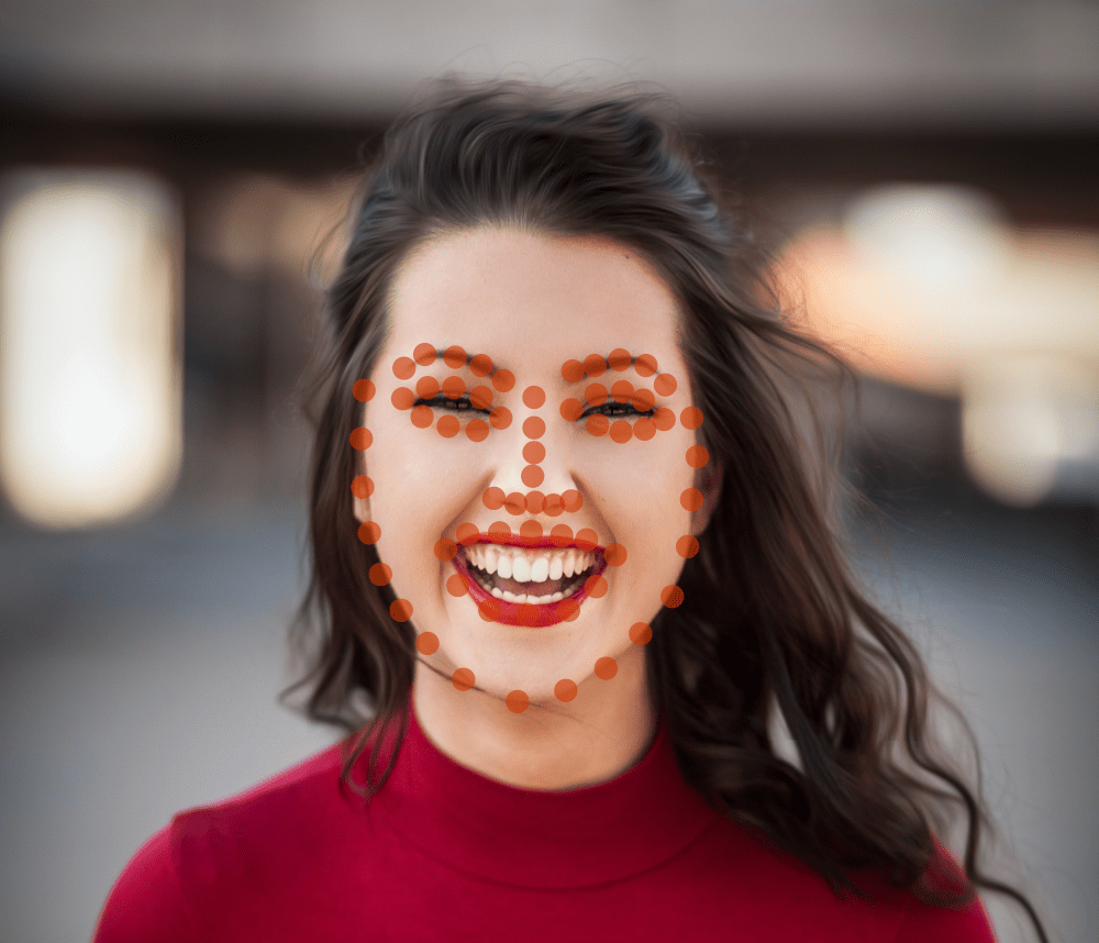 Woman smiling with detected face keypoints overlay