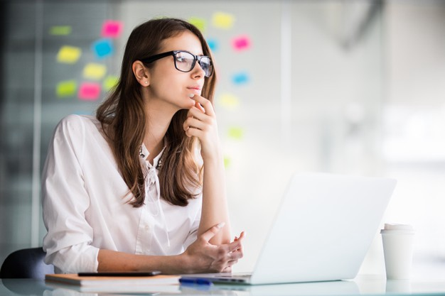 Woman is thinking in front of the laptop