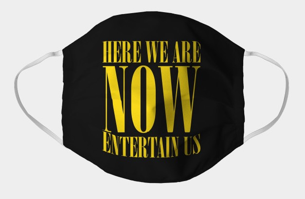 "A black facemask with ""Here we are now, Entertain Us"" written in yellow across the front"
