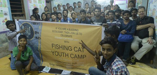 group of students and educators at a fishing cat camp
