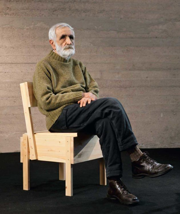Enzo Mari sitting on wood chair Sedia 1