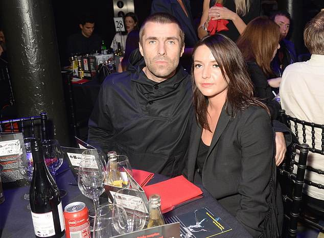 Liam Gallagher (pictured with girlfriend Debbie Gwyther in 2017) has been questioned under caution after CCTV images surfaced showing him appearing to grab his girlfriend by the throat