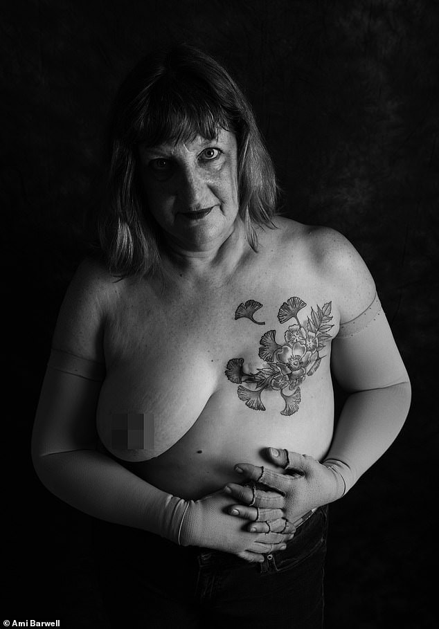 A black a white portrait of a person with one breast missing due to a masectomy with a tattoo over where the missing breast would be
