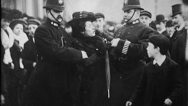 A suffragette being arrested in London while a crowd looks on, c. 1910