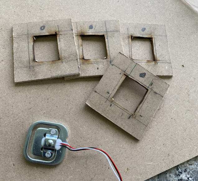 Wooden offset bracket for load cell
