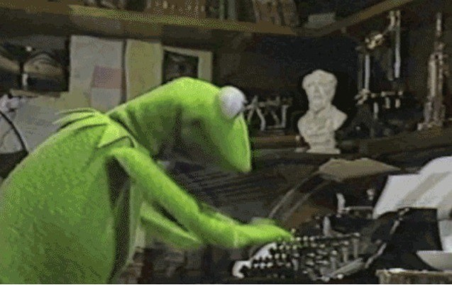 Kermit the Frog typing on a mechanical, old-style typewriter