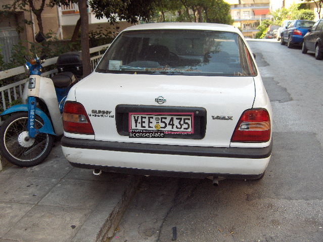A car with a license plate bounding box